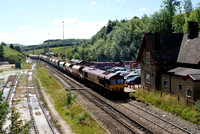 DBS 66167 passes the stabling point Tunstead with loaded stone hoppers.24/07/12
