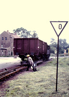 Shunter at work on the Oschatz - Mugeln narrow gauge line in East Germany - narrow gauge transporter wagons carrying standard gauge wagons.