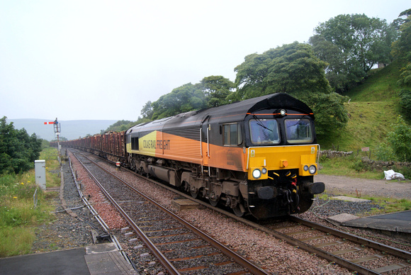 Colas Class 66 66848 on Chirk log train at Garsdale, S&C.15/08/12