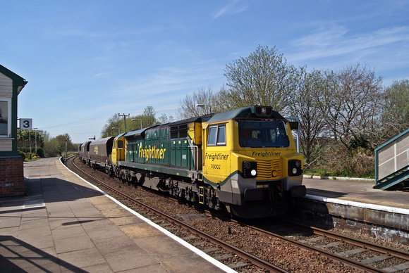 Freightliner Class 70 70002 passes through Helsby station working full coal hoppers to Fiddlers Ferry.