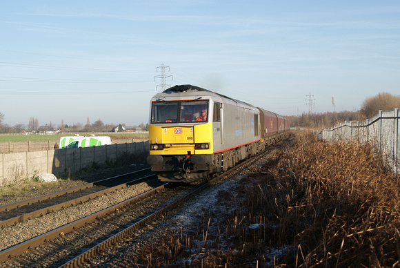 60099 on Fiddlers ferry coal hoppers. 16/01/12
