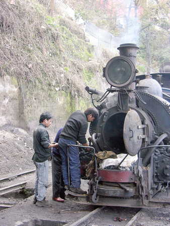Cleaning the smokebox of an Indian Railways 'B' Class tank at Darjeeling,2011.