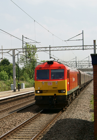 60054 in new DBS livery heads north on coal hoppers through Acton Bridge. 20.05.12